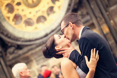 Bride and groom smiling in front of cathedral Royalty Free Stock Image