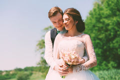 Bride and groom smiling on nature Royalty Free Stock Image