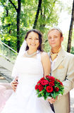 Bride and groom smiling outdoor Stock Photography