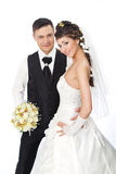 Bride and groom smiling. Wedding couple fashion. Beautiful bride and groom standing at white background. Wedding couple fashion shoot stock photo