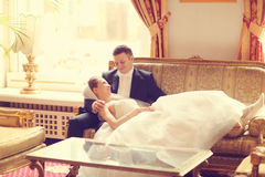 Bride and groom on sofa Royalty Free Stock Photography
