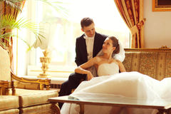 Bride and groom on sofa Royalty Free Stock Images
