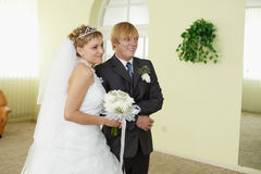 Bride and groom in solemn moment Stock Photos