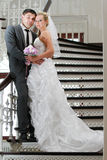 Bride and groom on the stair Stock Image