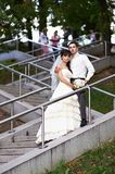 Bride and groom on stairs Royalty Free Stock Photography