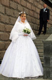 Bride and groom on stairs Stock Photo