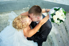 Bride and groom of the stairs. Bride and groom on the background of the stairs Stock Photography