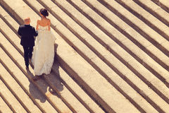 Bride and groom on stairs Stock Images