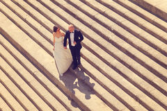Bride and groom on stairs Royalty Free Stock Image