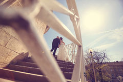 Bride and groom on stairs Stock Photos