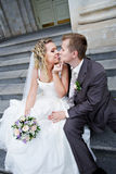 Bride and groom on stairs of palace Royalty Free Stock Photos