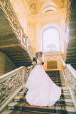 Bride and groom in stairs Royalty Free Stock Photos