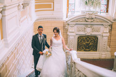 Bride and groom in stairs Stock Photos