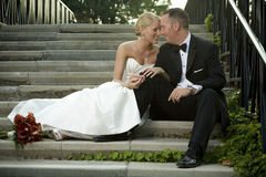 Bride and Groom on Stairway royalty free stock photography