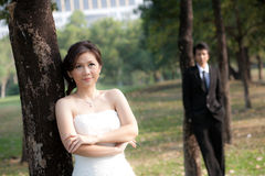 Bride and groom stand in the garden Royalty Free Stock Photos