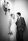 Bride and groom stand near lights candles Royalty Free Stock Image