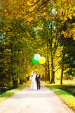 Bride and groom standing in the alley with balloons Stock Photo