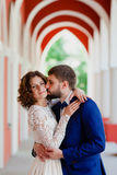 Bride and groom standing in the arch Stock Image