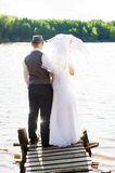 Bride and groom standing on the bridge Royalty Free Stock Images