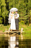 The bride and groom are standing on the bridge Royalty Free Stock Photos