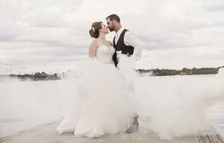Bride and Groom standing in fog Royalty Free Stock Photography