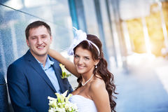Bride and groom is standing granite wall Royalty Free Stock Image