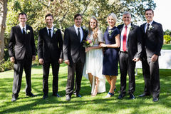 Bride and groom standing with guests Stock Photo