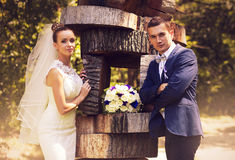 Bride and groom standing near sculpture Stock Photos
