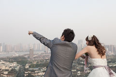 Bride and groom standing  ouside with huangpu river Stock Images