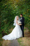 Bride and groom standing in park Royalty Free Stock Photo