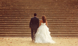 Bride and groom. Standing on stairs Stock Photography