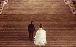 Bride and groom. Standing on stairs Royalty Free Stock Images