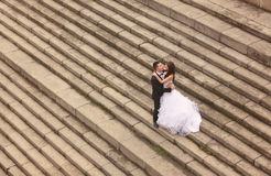 Bride and groom standing on stairs Stock Photography