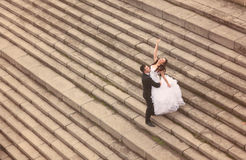 Bride and groom standing on stairs Royalty Free Stock Images
