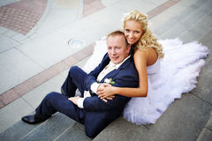 Bride and groom on steps of palace Stock Photography