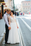 Bride and groom on the street Royalty Free Stock Photos