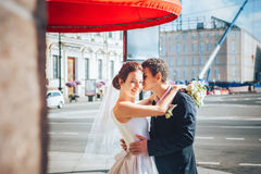 Bride and Groom at the Street Stock Photo