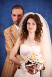 Bride and groom  in studio. Bride and groom over blue studio background Royalty Free Stock Photography