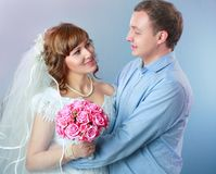 Bride and groom in studio Royalty Free Stock Photography