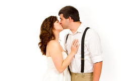 Bride and Groom in Studio. An attractive women and her handsome husband wear their wedding attire in the studio agains an isolated white background Royalty Free Stock Photography