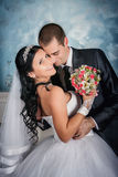 Bride and groom  in studio Royalty Free Stock Photos