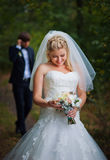 Bride and groom in the summer forest Stock Photo