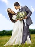 Bride and groom summer outdoor. Royalty Free Stock Photography