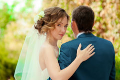 The bride and groom in summer park Stock Photo