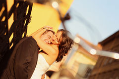 Bride on groom on a sunny day having fun Royalty Free Stock Photo