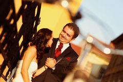 Bride on groom on a sunny day having fun Royalty Free Stock Photography