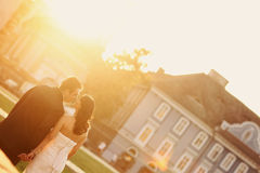 Bride on groom on a sunny day having fun Royalty Free Stock Image