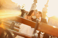 Bride on groom on a sunny day having fun Royalty Free Stock Images