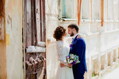 The bride and groom on the sunny street Royalty Free Stock Photography