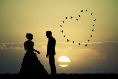 Bride and groom at sunset Stock Photography